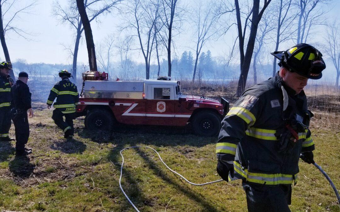 Firefighters at a grass fire