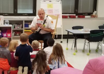 Reading to a classroom of students