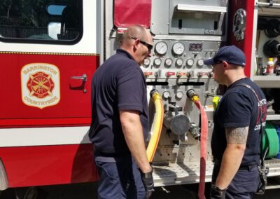 Firefighters Discussing Lines