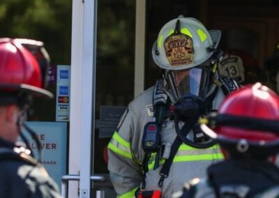 Firefighter Emerging from a Building